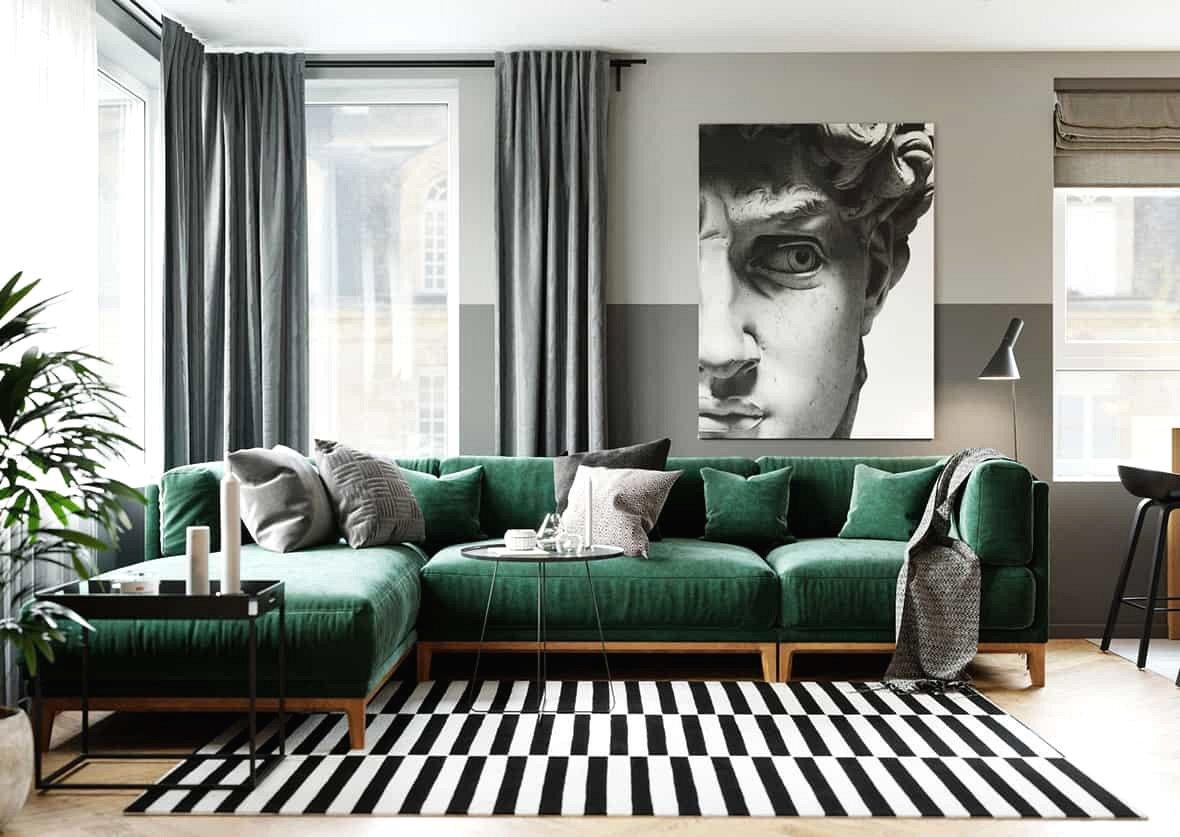 Phòng khách thông thoáng với ghế sofa màu xanh ngọc tinh tế thu hút. Chủ nhân căn hộ yêu thích lựa chọn màu sắc trung tính cho đồ nội thất và trang trí.