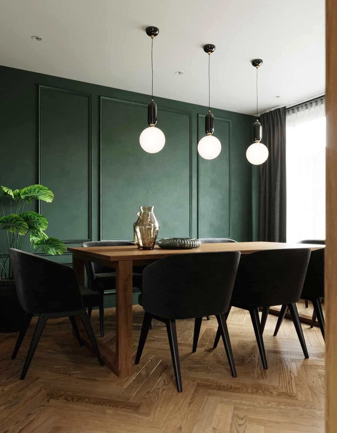 Phòng ăn được bố trí ở góc phòng với bức tường màu xanh, đèn tròn cổ điển cung cấp ánh sáng nhẹ.