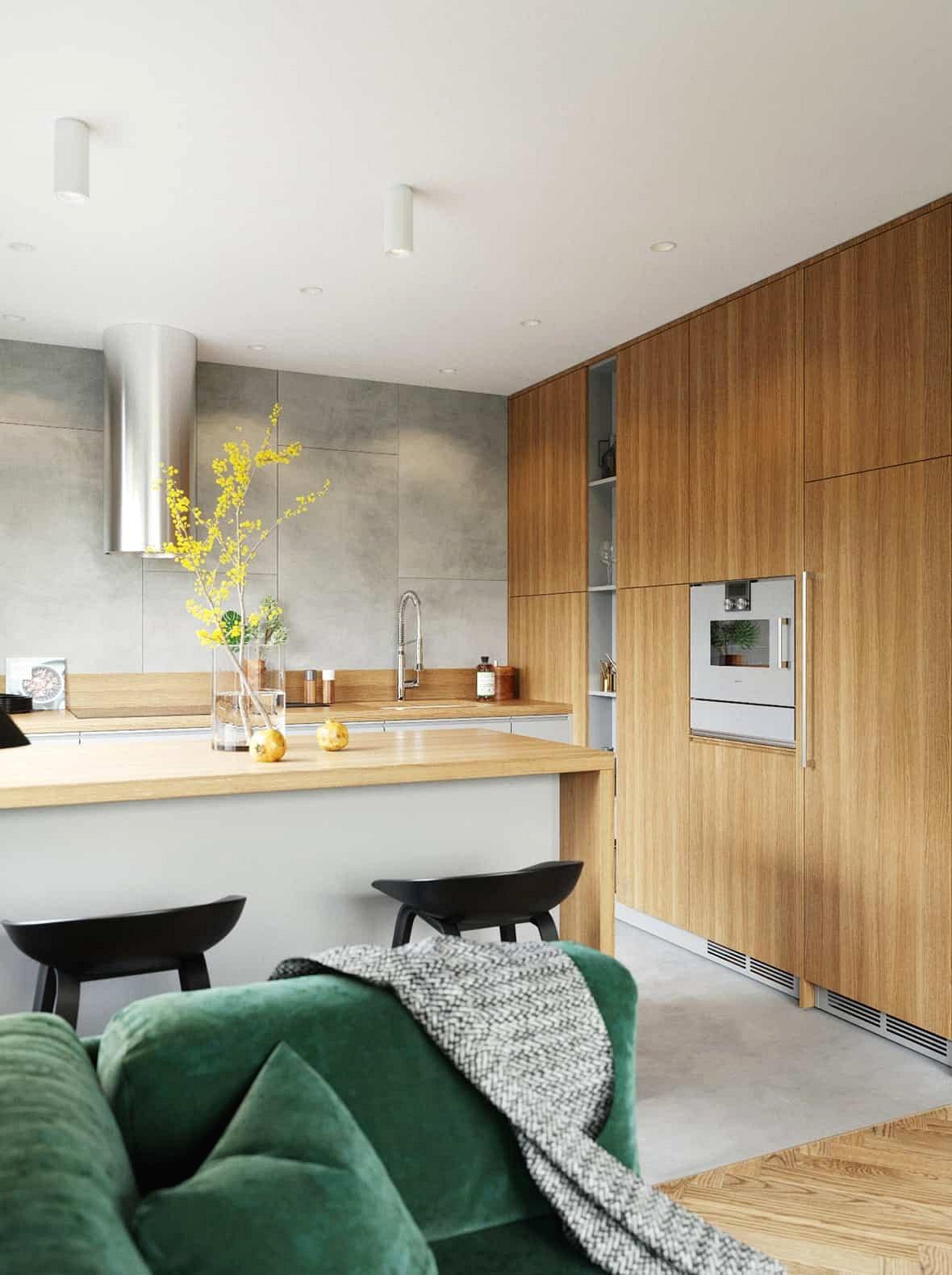 Vật liệu tự nhiên một lần nữa được sử dụng ở đây. Vách đá màu xám trải dài trên toàn bộ bức tường thành trong khi các vân gỗ thẳng đứng tạo ra sự tiếp nối liền mạch giữa mặt bàn và tủ.